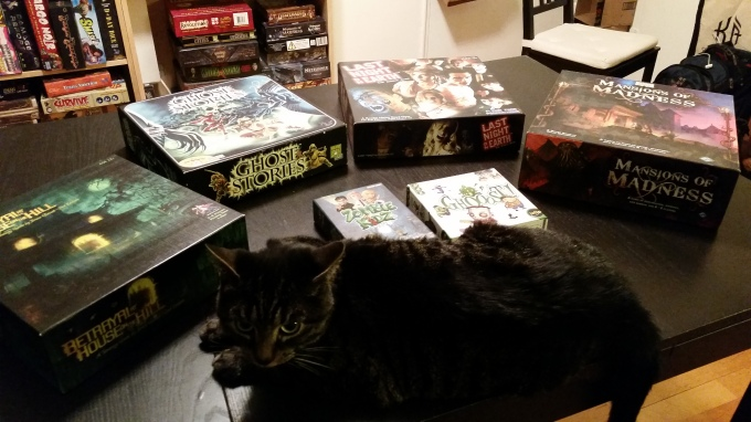Standing in for the Alien deck building game is this unhelpful yet adorable cat.