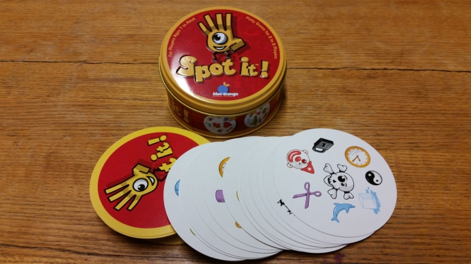 A candy-colorful tin and cutsie artwork mask a game easy enough for kids and fun enough for adults.