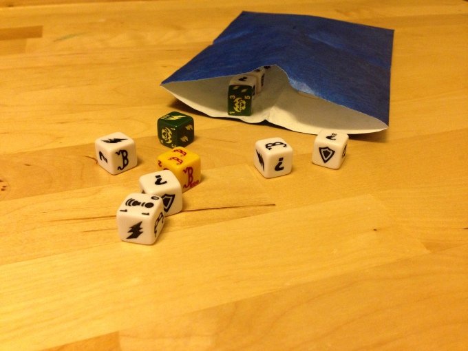 "The included dice ""bags"" are kind of silly, but they're better than nothing."