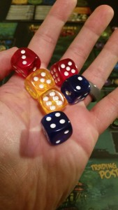 Extra dice, granted by treasure cards. The Yellow ones are free to reroll, the red ones never reroll, and the blue ones can be manipulated directly.
